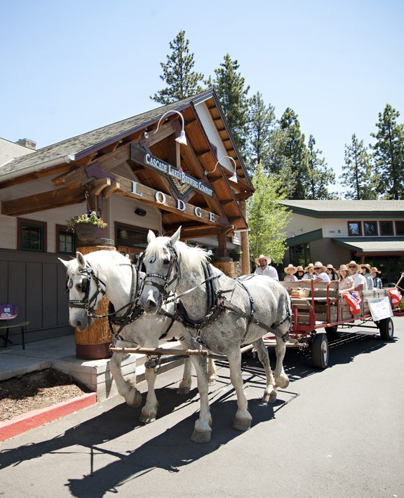 fron view of cowboy carriage in front of cascade lakes brewery