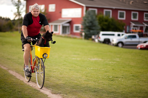The late Bob Wenger, a devoted dog advocate, loved biking in Bend with his dog, Ryder.