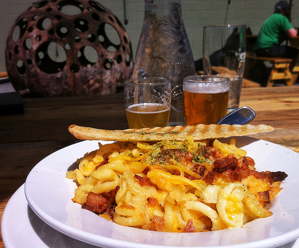 The ultimate comfort food: mac & cheese made with beer and topped with bacon at Crux Fermentation Project.