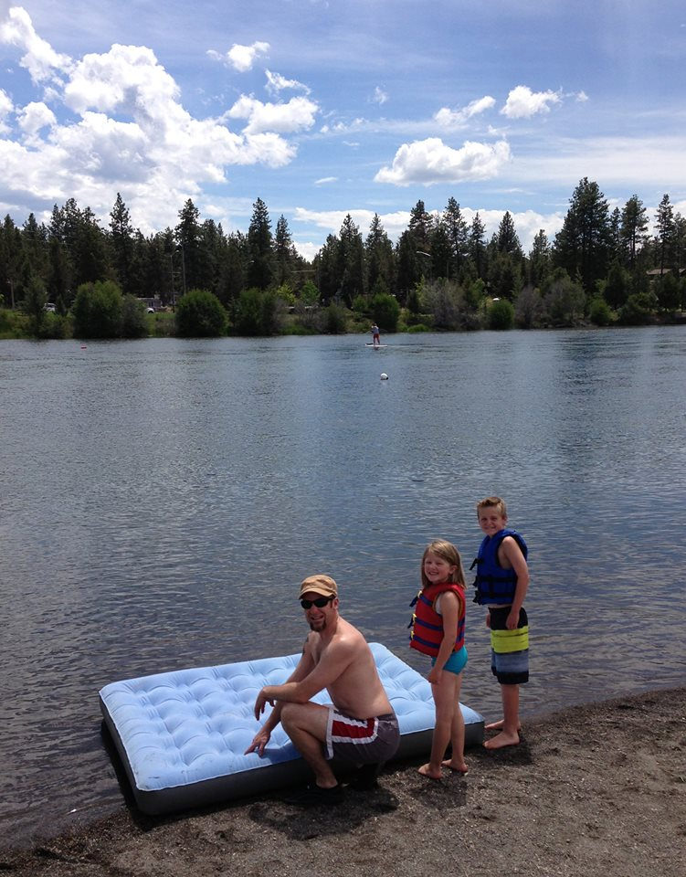 My gentleman friend and his delightful offspring as we prepare for our Father's Day river float this past weekend.