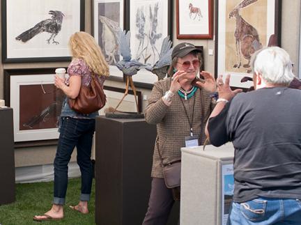 Customers admire work by artist Danae Miller.