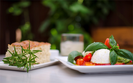 The foccacia and the caprese salad at Ariana's both prominently feature their home-grown herbs.