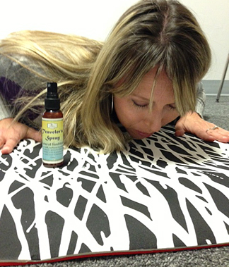Lynnette Braillard can't stop sniffing her yoga mat after spritzing it with Traveler's Spray.