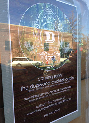 The sign in the window at the new Dogwood Coctail Cabin hints at great things to come!