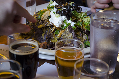 Grab a gluten-free beer and a plate of nachos at Broken Top Bottle Shop.