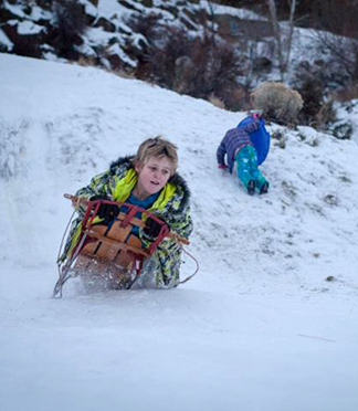 Catching some air on the sledding hill at Al Moody Park in northeast Bend.