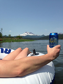 Blogger Tawna enjoys a can of Sweet As on Elk Lake last summer.