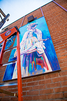 Klondike Kate is honored in one of the newest paintings added to the Tin Pan Alley art collection. The painting was created by Sheila Dunn, and can be seen in the alley beside Toomie's Thai Cuisine.