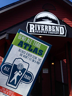 The new Bend Ale Trail atlas in front of one of the newest breweries to join the program, Riverbend Brewing.