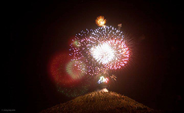 Fireworks burst above Pilot Butte.