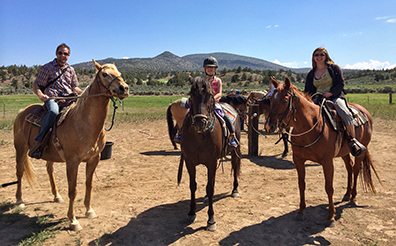 Visit Bend blogger, Tawna, enjoying a morning horseback ride at Brasada Ranch with her family.