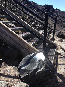 Big, glassy hunks of obsidian adorn the trail at the Big Obsidian Flow.