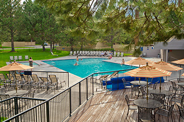 The pine-fringed pool at Mt. Bachelor Village Resort is a great place to lounge in the summer, but you need to book early if you want to visit in peak season.