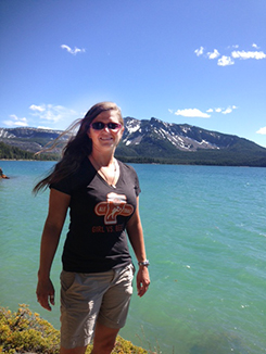 Blogger Tawna on the shore of Paulina Lake (and yes, the water really looks that turquoise!)