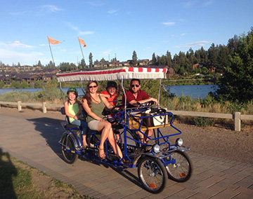 The Fenske-Zagurski clan enjoys a surrey ride through the Old Mill District, courtesy of Wheel Fun Rentals.