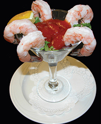 Enjoy inexpensive shrimp cocktail and some killer river views during happy hour at Crossings at the Riverhouse.