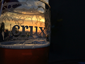 The only thing better than Sunset Hour at Crux Fermentation Project, is watching the sunset through your rapidly dwindling pint of Crux brew.