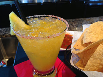 The Man Van Margarita (packed with flavors of citrus and vanilla) is a must-try during happy hour at La Rosa.