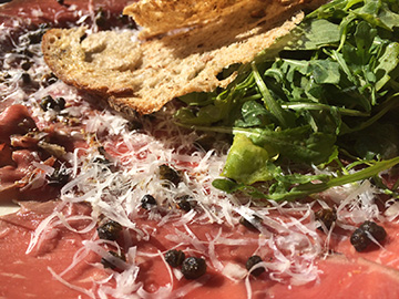 The carpaccio at 900 Wall is one of the best in Bend, and you'll find it on the happy hour menu.