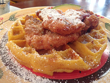 You've never had chicken and waffles like the one at La Magie Bakery.