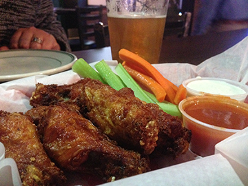 Mouthwatering wings at Sidelines let you control your own sauce distribution.