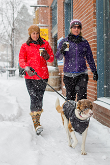 Snow enthusiasts stroll the streets of Downtown Bend on November 30.