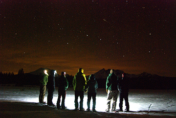 Snowshoeing by starlight is one of those once-in-a-lifetime activities you can enjoy with Wanderlust Tours in Bend.