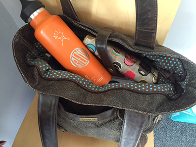 Blogger Tawna's handbag with its ever-present Hydro Flask. Don't leave home without your own stash of water if you're planning a night (or a day) on the town.