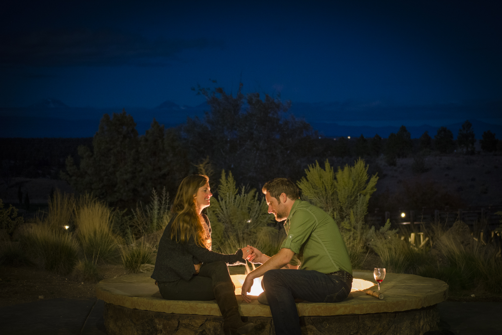Blogger Tawna and her husband, Craig, enjoy a romantic evening by their private fire pit outside their suite at Brasada Ranch.