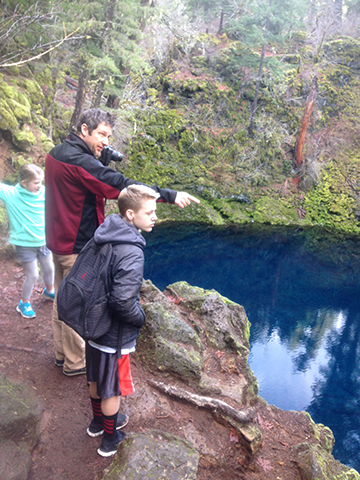 Craig and the kids on the edge of Blue Pool.