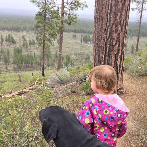 Hank's daughter, Rose, gets a taste of the outdoors with canine companion, Toby.