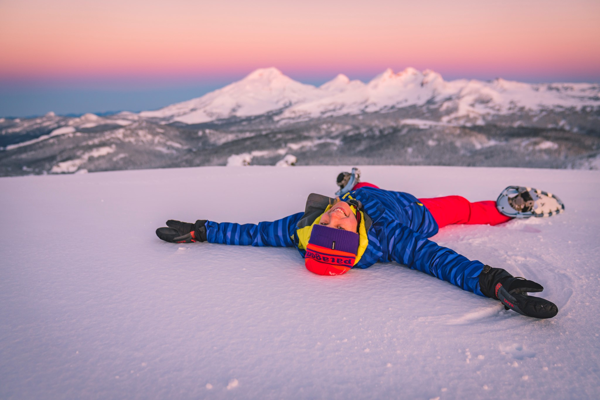 Making a snow angel with a view of the Cascade Mountains.