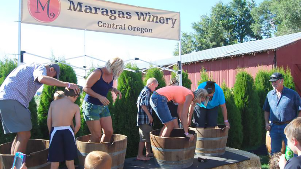 https://www.visitbend.com/wp-content/uploads/2018/04/maragas-winery-annual-grape-stomp-960.jpg