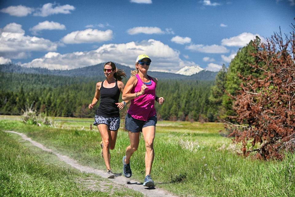 https://www.visitbend.com/wp-content/uploads/2018/09/LARK-Running_2-on-trail.jpg