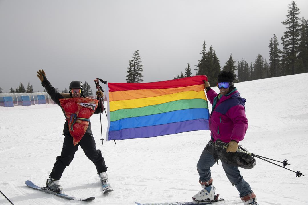 Skiers with rainbow gay pride flag