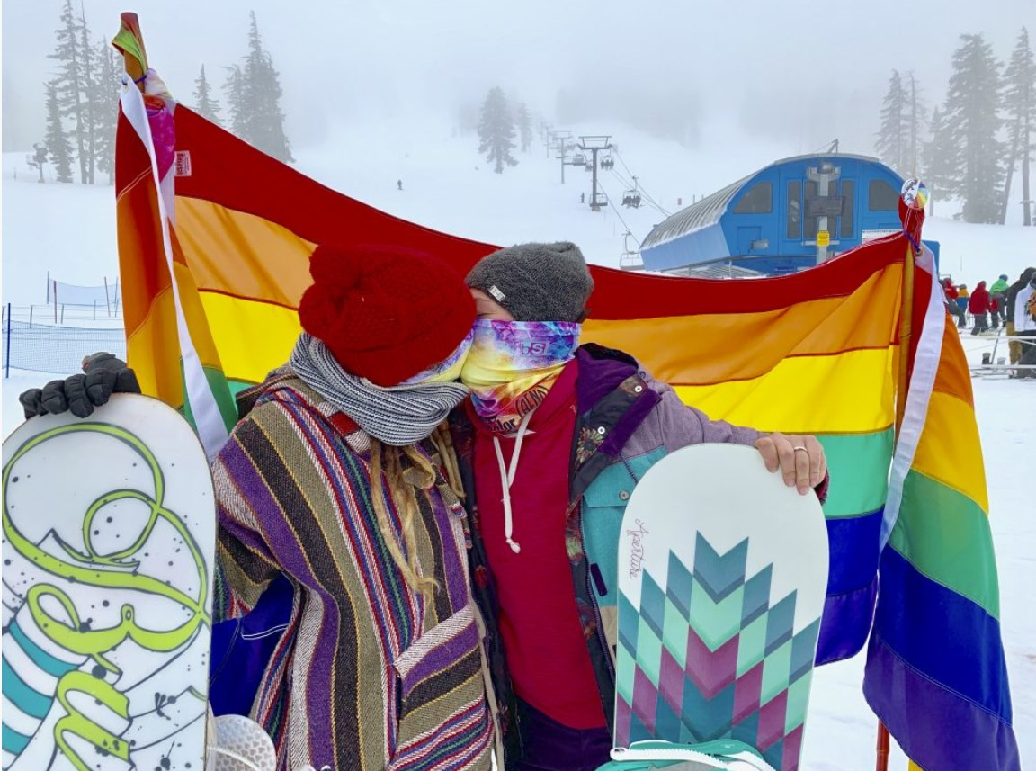 PrideFest kiss between snowboarders at Mt. Bachelor