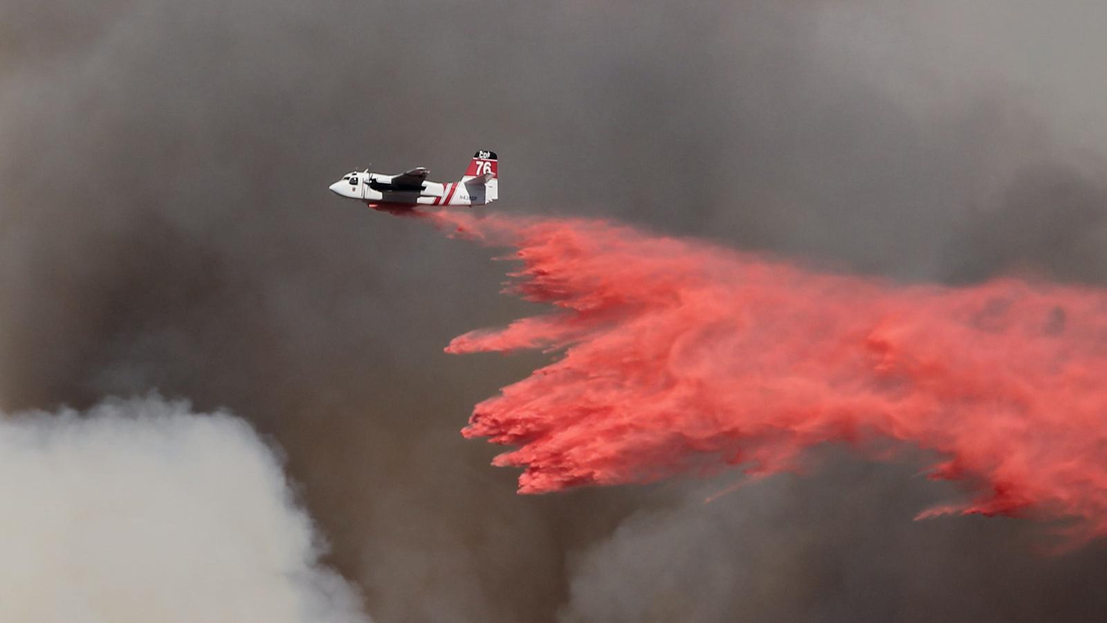 Air Tanker Drops Retardant on Wildfire